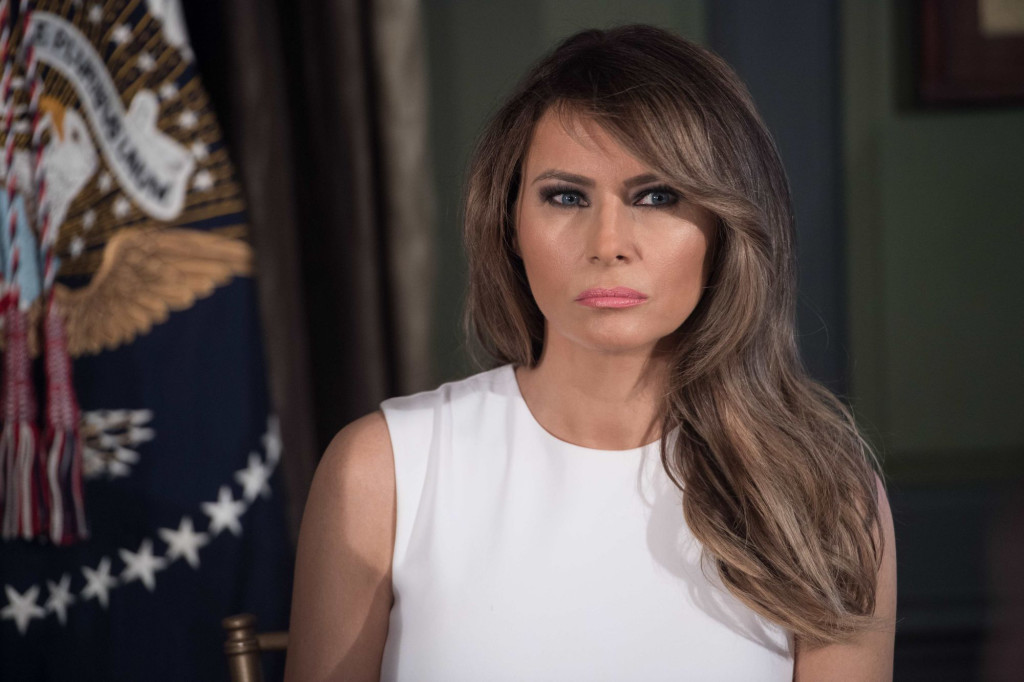 US First Lady Melania Trump looks on as her husband President Donald Trump speaks at a meeting with administration on the opioid addiction crisis at the Trump National Golf Club in Bedminster, New Jersey, on August 8, 2017. / AFP PHOTO / NICHOLAS KAMM (Photo credit should read NICHOLAS KAMM/AFP/Getty Images)