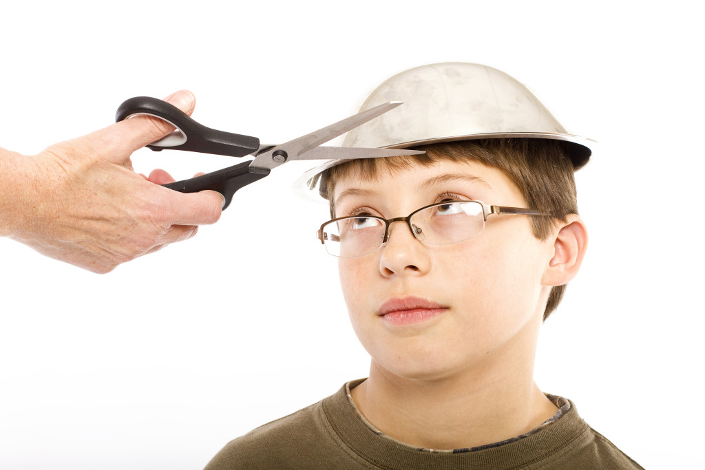 A young boy getting ready for a pudding bowl haircut